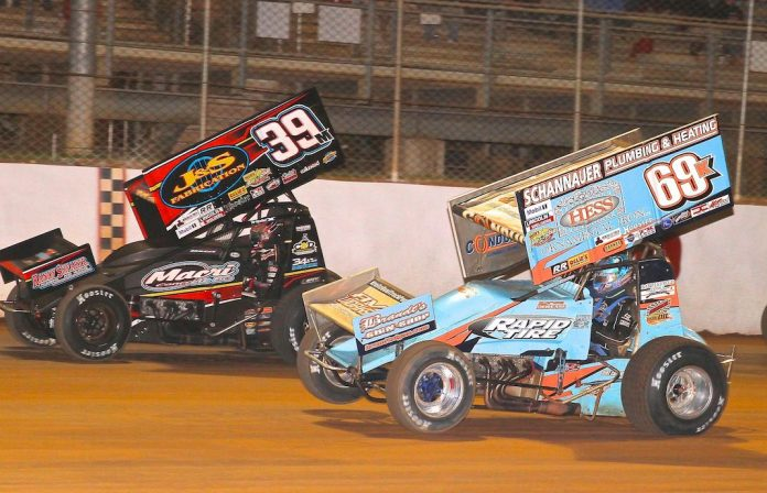 Lance Dewease (69k) races under Anthony Macri at Port Royal Speedway. (Dan Demarco photo)