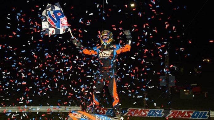 Chris Windom celebrates victory at Bloomington Speedway. (David Nearpass photo)