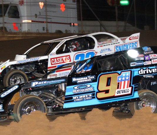Zack VanderBeek (33Z) and Joe Duvall (91) battle side by side on the opening lap of Friday night's USMTS feature at Ark-La-Tex Speedway. (Scott Burson Photo)