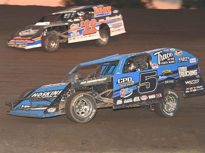 Todd Shute (5) battles Kyle Heckman during the second modified qualifier early Saturday evening at Boone Speedway. (Tom Macht Photo)