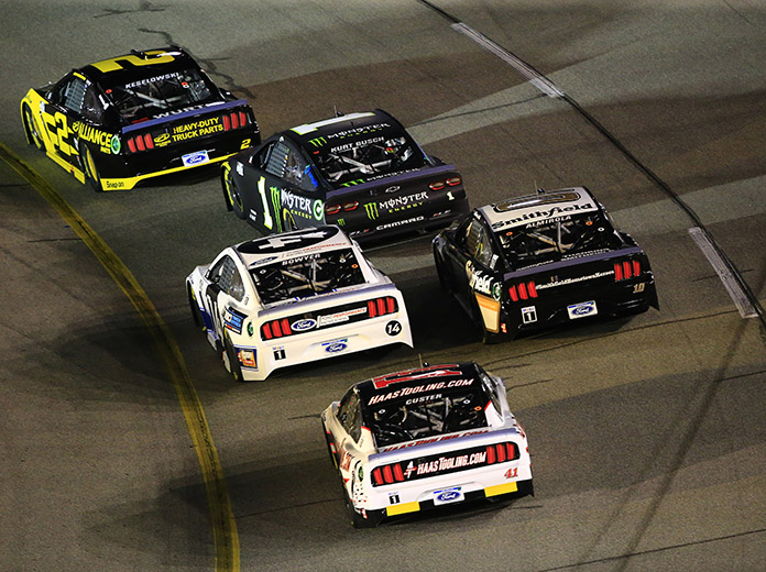 Brad Keselowski (2) leads a pack of cars Saturday at Richmond Raceway. (HHP/Jim Fluharty Photo)