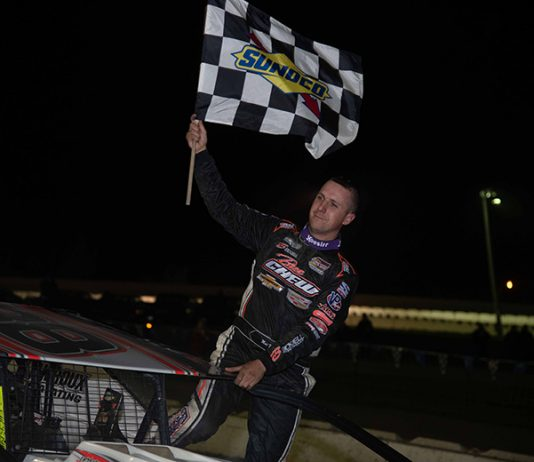 Mat Williamson celebrates a $10,000 victory Saturday at Devil's Bowl Speedway. (Dylan Friebel Photo)