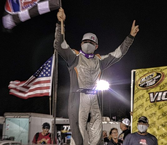 Layne Riggs celebrates after winning the Solid Rock Carriers CARS Tour Late Model Stock feature at Bobby Watson's Carteret County Speedway. (Andy Marquis photo)