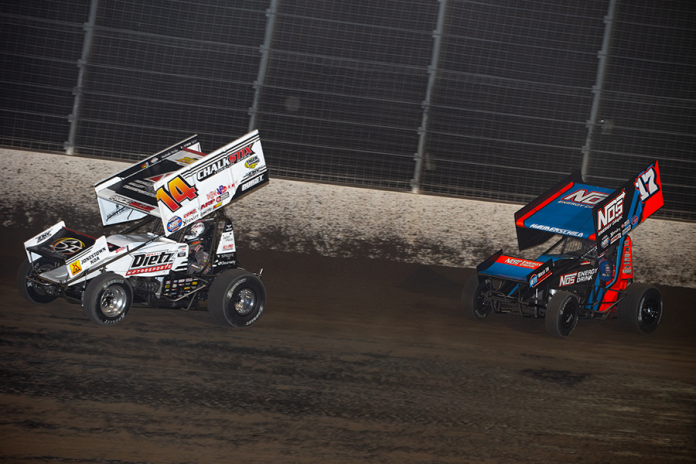 Sheldon Haudenschild (17) chases Parker Price-Miller at Dodge City Raceway Park. (Trent Gower photo)