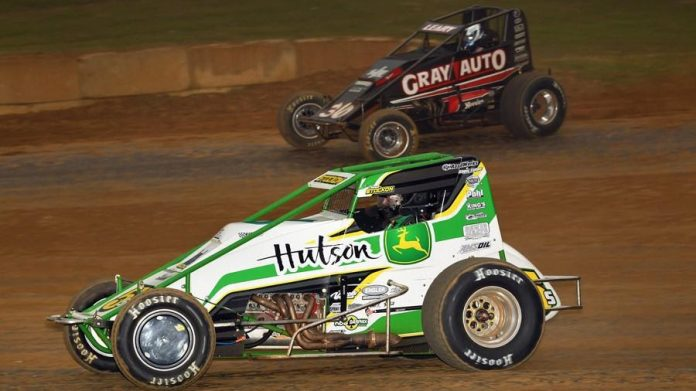 Chase Stockon charges under Dave Darland at Lincoln Park Speedway. (David Nearpass photo)