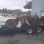 Raymond Reynolds stands beside his totaled street stock following a crash Saturday at Hidden Valley Speedway.