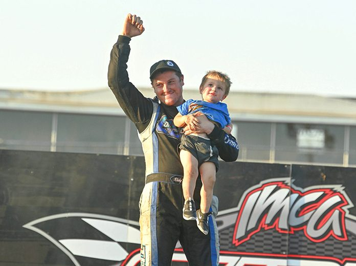 Ricky Thornton Jr. celebrates with his son in victory lane after winning the modified finale during the IMCA Speedway Motors Super Nationals. (Tom Macht Photo)