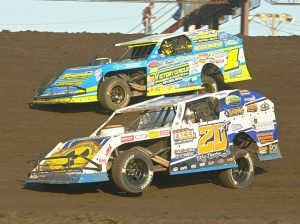 Ricky Thornton Jr. (20) battles Ethan Dotson during the IMCA Speedway Motors Super Nationals modified finale Sunday at Boone Speedway. (Tom Macht Photo)