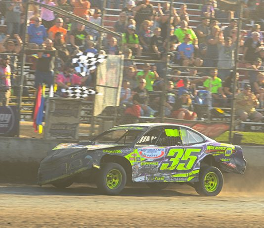 Donavon Smith crosses the finish line to win the IMCA Speedway Motors Super Nationals stock car finale Sunday at Boone Speedway. (Tom Macht Photo)