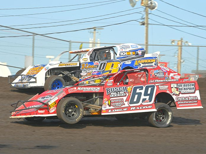 Johnathon Logue (69) battles alongside Brett Berry during the Northern sportmod feature during the IMCA Speedway Motors Super Nationals Sunday at Boone Speedway. (Tom Macht Photo)