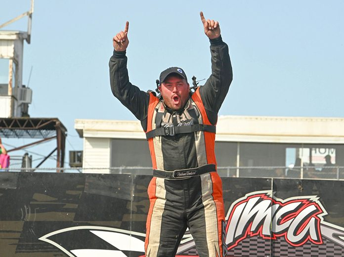 Nathan Ballard celebrates after winning the hobby stock feature during the IMCA Speedway Motors Super Nationals Sunday at Boone Speedway. (Tom Macht Photo)