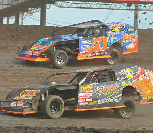 Jesse Sobbing (999) battles Troy Cordes during the IMCA modified Race of Champions on Sunday during the IMCA Speedway Motors Super Nationals at Boone Speedway. (Tom Macht Photo)