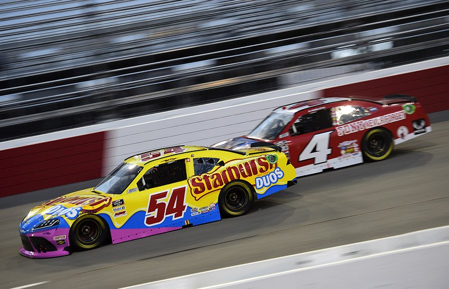 Kyle Busch (54) passes Jesse Little during Friday's NASCAR Xfinity Series event at Richmond Raceway. (NASCAR Photo)