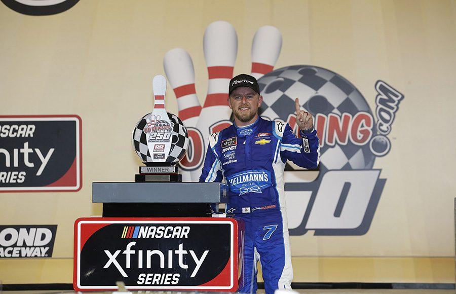 Justin Allgaier poses in victory lane after winning Friday's NASCAR Xfinity Series race at Richmond Raceway. (HHP/Harold Hinson Photo)