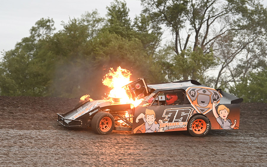The Northern sportmod car of Chance Huston burns after a fuel cell from another competitor landed in his window during the IMCA Speedway Motors Super Nationals fueled by Casey's at Boone Speedway. (Tom Macht Photo)
