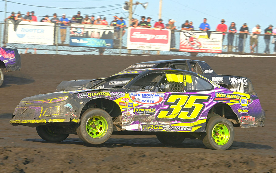 Stock cars battle for supremacy during the IMCA Speedway Motors Super Nationals fueled by Casey's at Boone Speedway. (Tom Macht Photo)