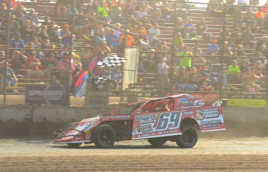 Johnathon Logue takes the checkered flag to win the Northern sportmod finale Sunday during the IMCA Speedway Motors Super Nationals fueled by Casey's at Boone Speedway. (Tom Macht Photo)