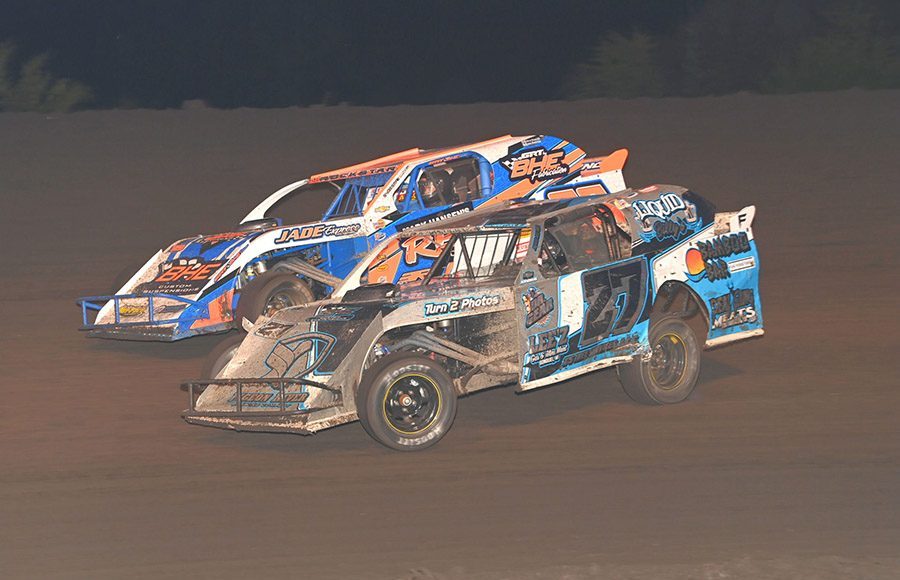 Northern sportmod drivers race for position during the IMCA Speedway Motors Super Nationals fueled by Casey's at Boone Speedway. (Tom Macht Photo)