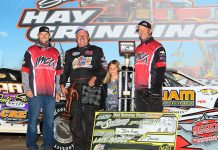 Jeff Aikey added to his career-best total with his 71st Summer Series victory, during the Dale De­France Memorial program at Marshalltown Speedway. He is pictured with IMCA President Brett Root, trophy presenter Dayna Murty and Series Director Kevin Yoder. (Bruce Badgley Photo)
