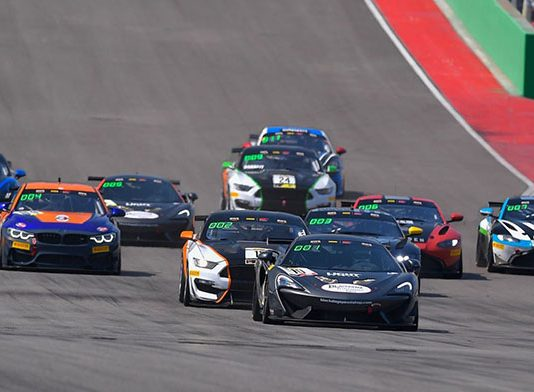 The Pirelli GT4 America Sprint field storms down the front straight Friday at Circuit of the Americas.