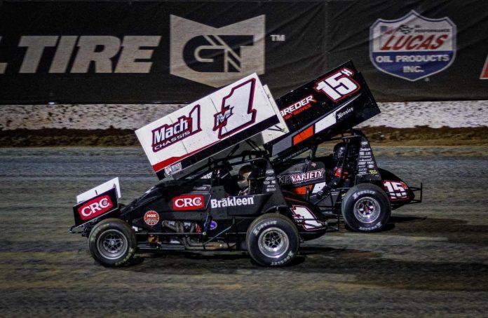 Mark Smith (1) and Sam Hafertepe Jr. at Lucas Oil Speedway. (Greg Stanek photo)