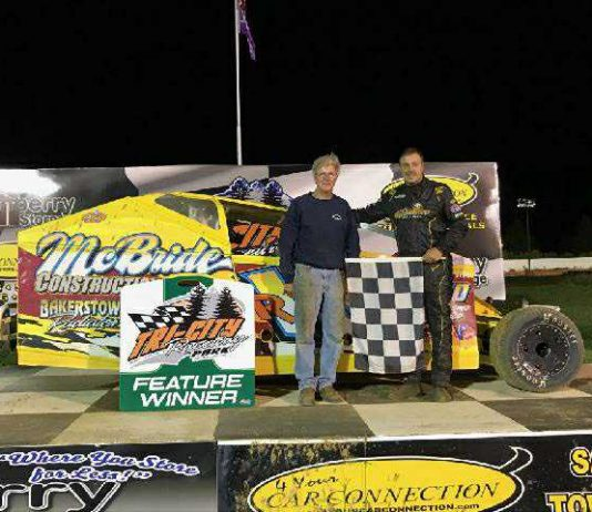 Rick Regalski (right) celebrated on the 4-Your-Car-Connection Victory Lane Stage after the Non-Winners' Race for Small Block Modified race cars on the opening night of the Applefest Race Weekend at Tri-City Raceway Park.
