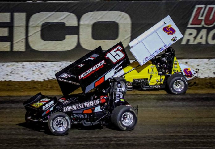 Sam Hafertepe Jr. (15h) battles Derek Hagar at Lucas Oil Speedway. (Greg Stanek photo)