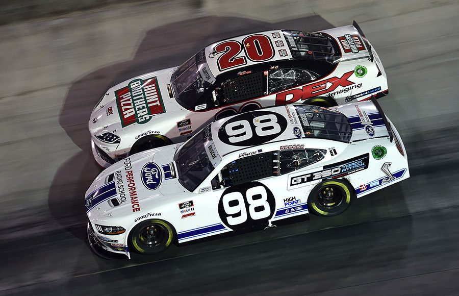 Chase Briscoe (98) races under Harrison Burton during Friday's Food City 300 at Bristol Motor Speedway. (Jared C. Tilton/Getty Images)