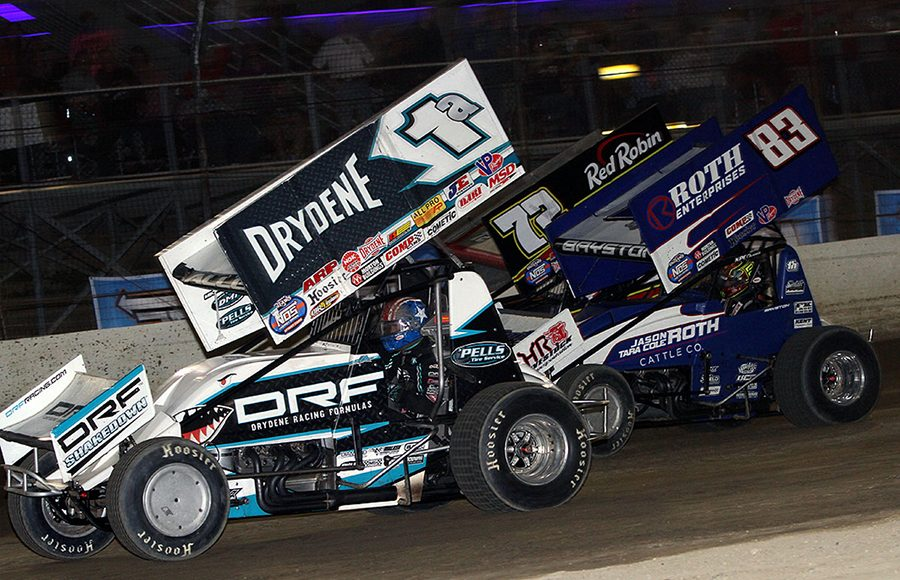 Jacob Allen (1a), Spencer Bayston (83) and Daryn Pittman battle for position during Thursday's World of Outlaws NOS Energy Drink Sprint Car Series event at Plymouth Speedway. (Jim Denhamer Photo)