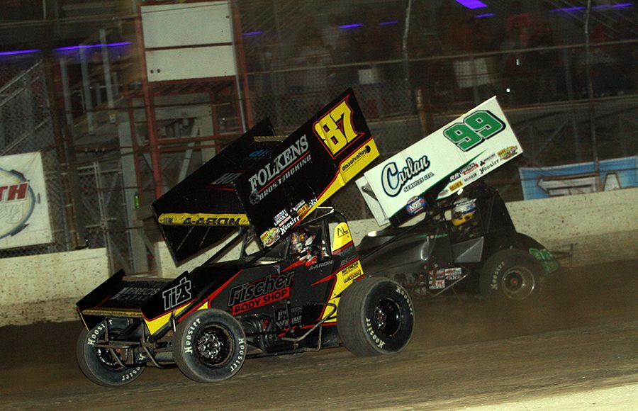 Aaron Reutzel (87) leads Skylar Gee during Thursday's World of Outlaws NOS Energy Drink Sprint Car Series event at Plymouth Speedway. (Jim Denhamer Photo)