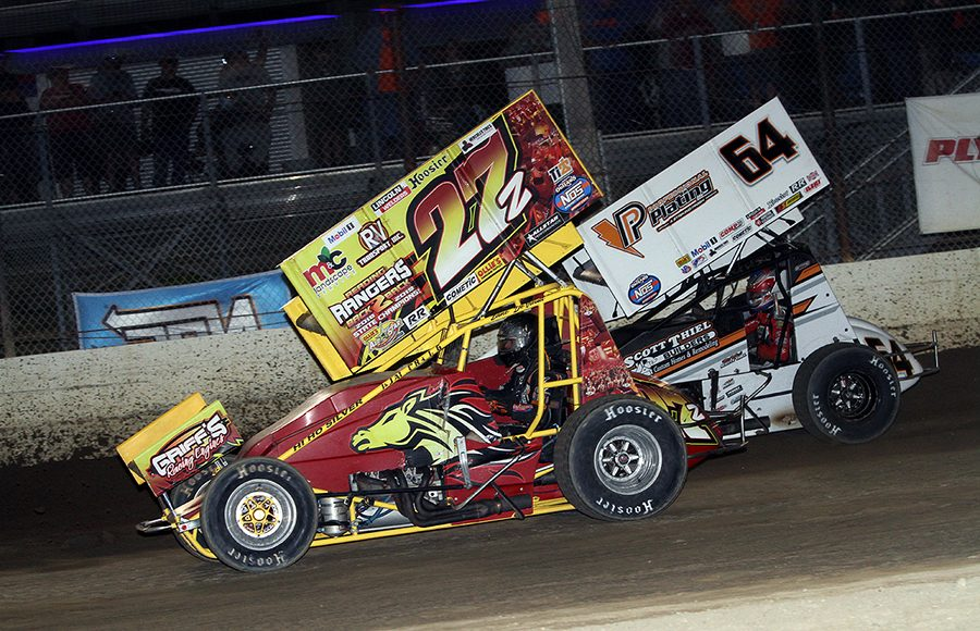 Zane Devault (27z) battles Scotty Thiel during Thursday's World of Outlaws NOS Energy Drink Sprint Car Series event at Plymouth Speedway. (Jim Denhamer Photo)
