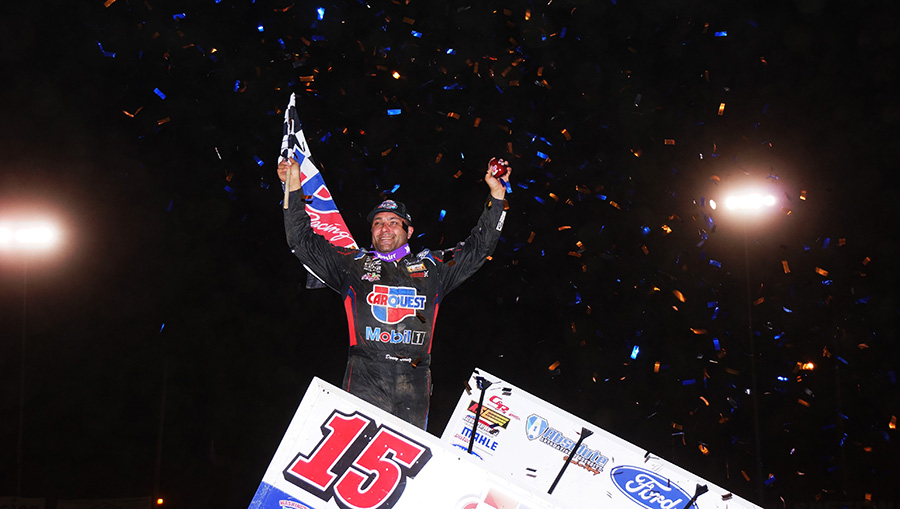 Donny Schatz celebrates after winning Thursday's World of Outlaws NOS Energy Drink Sprint Car Series event at Plymouth Speedway. (Gary Gasper Photo)