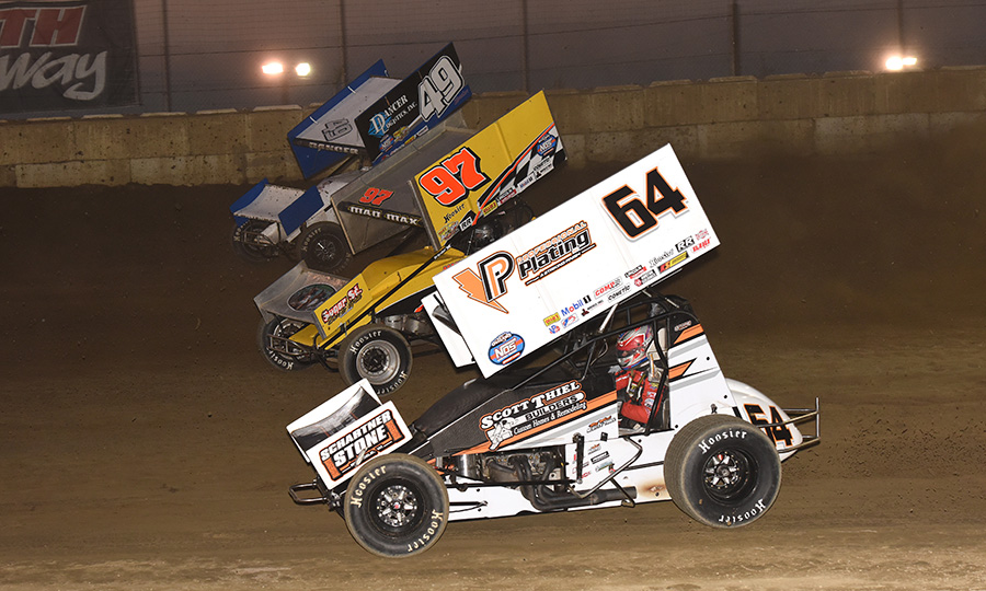 Scotty Thiel (64), Max Stambaugh (97) and Shawn Dancer race three-wide during Thursday's World of Outlaws NOS Energy Drink Sprint Car Series event at Plymouth Speedway. (Paul Arch Photo)