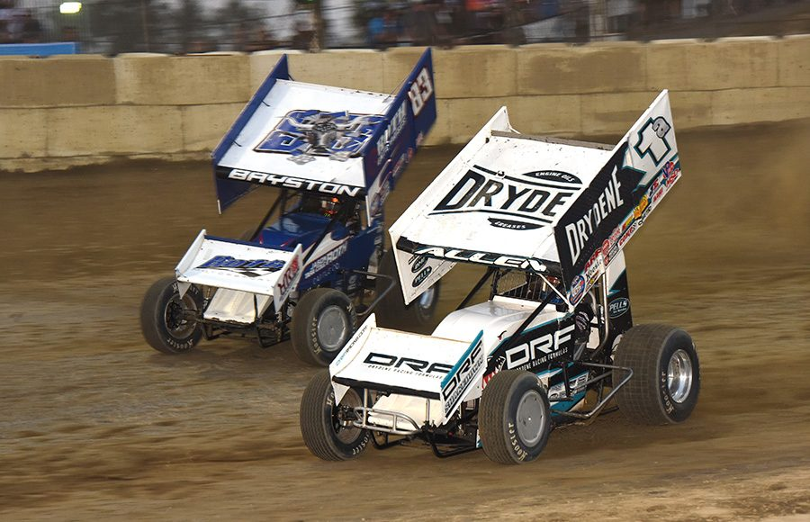 Jacob Allen (1a) races to the inside of Spencer Bayston during Thursday's World of Outlaws NOS Energy Drink Sprint Car Series event at Plymouth Speedway. (Paul Arch Photo)