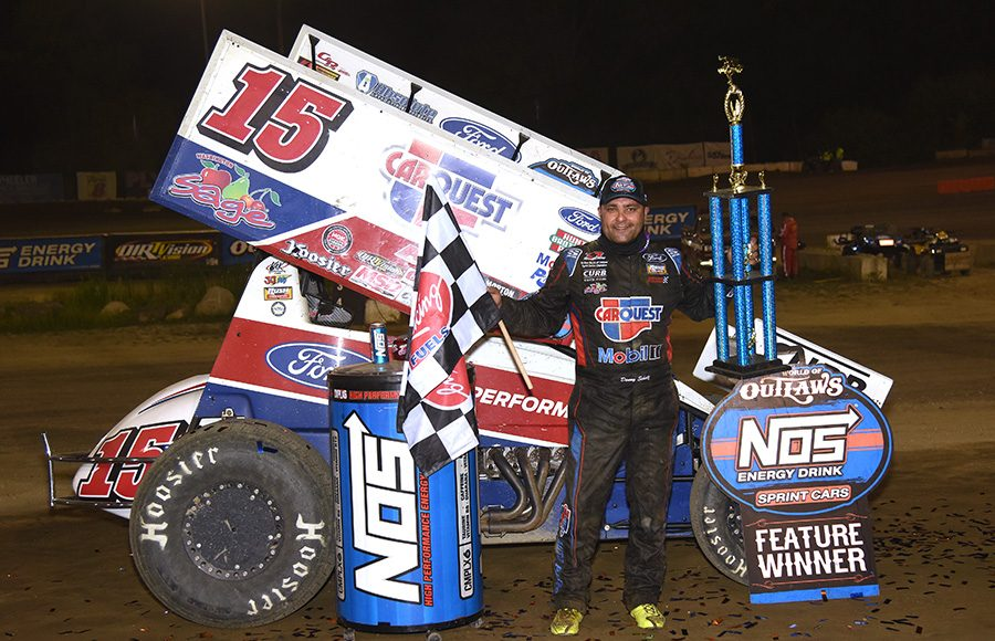 Donny Schatz poses in victory lane after winning Thursday's World of Outlaws NOS Energy Drink Sprint Car Series event at Plymouth Speedway. (Paul Arch Photo)