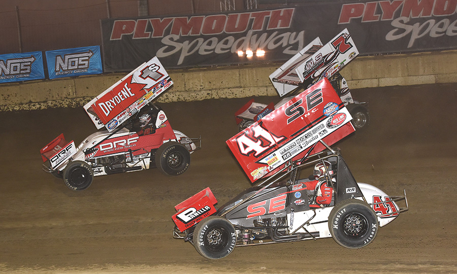 Logan Schuchart (1s), Dominic Scelzi (41) and Jason Sides battle for position during Thursday's World of Outlaws NOS Energy Drink Sprint Car Series event at Plymouth Speedway. (Paul Arch Photo)