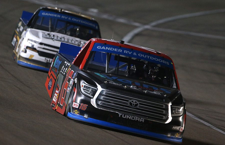 Austin Hill (16) races ahead of Sheldon Creed during Friday's NASCAR Gander RV & Outdoors Truck Series event at Las Vegas Motor Speedway. (NASCAR Photo)
