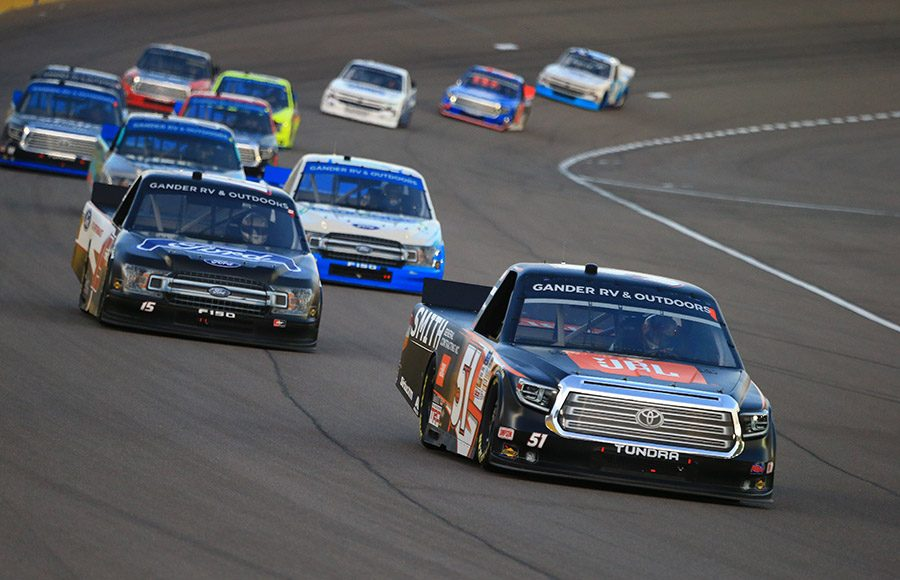 Chandler Smith (51) leads a pack of cars during Friday's NASCAR Gander RV & Outdoors Truck Series race at Las Vegas Motor Speedway. (HHP/Jeff Fluharty Photo)