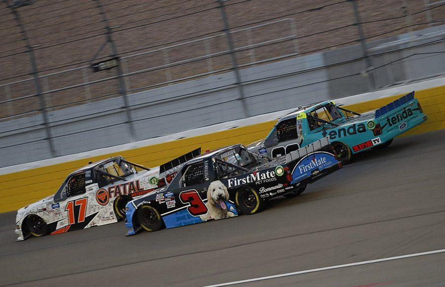 Dylan Lupton (17), Jordan Anderson (3) and Ben Rhodes battle for position during Friday's NASCAR Gander RV & Outdoors Truck Series race at Las Vegas Motor Speedway. (HHP/Harold Hinson Photo)