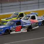 Stewart Friesen (52), Tate Fogleman (02) and Matt Crafton battle three-wide during Friday's NASCAR Gander RV & Outdoors Truck Series race at Las Vegas Motor Speedway. (HHP/Harold Hinson Photo)