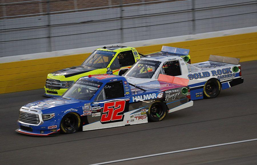 Stewart Friesen (52), Tate Fogleman (02) and Matt Crafton battle three-wide during Friday's NASCAR Gander RV & Outdoors Truck Series race at Las Vegas Motor Speedway. (HHP/Harold Hinson Photo)