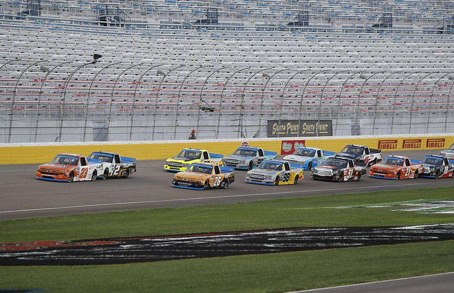 Drivers battle for position during a restart in Friday's NASCAR Gander RV & Outdoors Truck Series event at Las Vegas Motor Speedway. (HHP/Harold Hinson Photo)