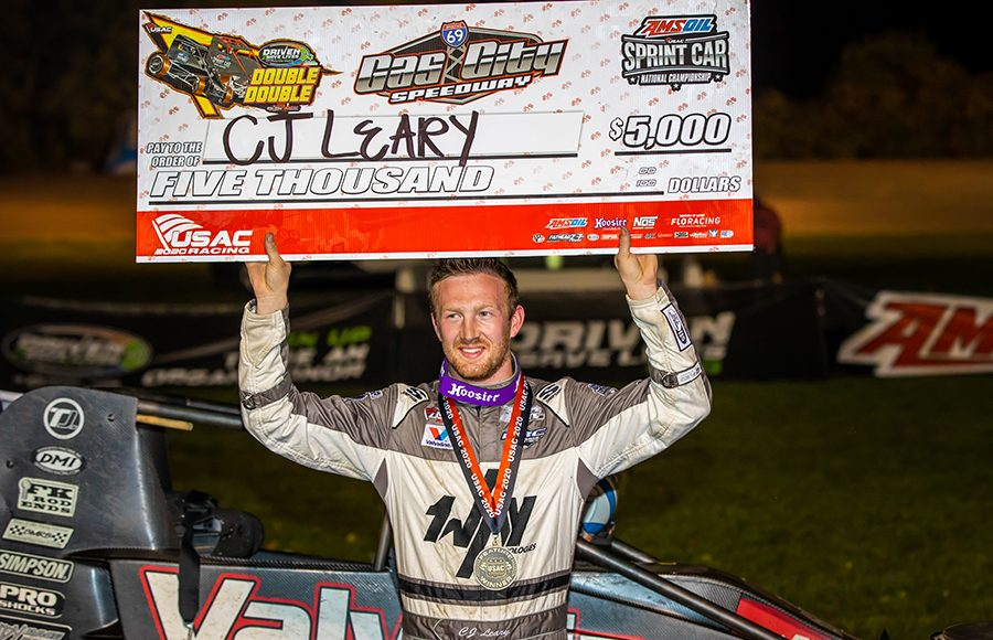 C.J. Leary poses in victory lane following his victory in Friday's USAC AMSOIL National Sprint Car Series event at Gas City I-69 Speedway. (Eli Kaikko Photo)