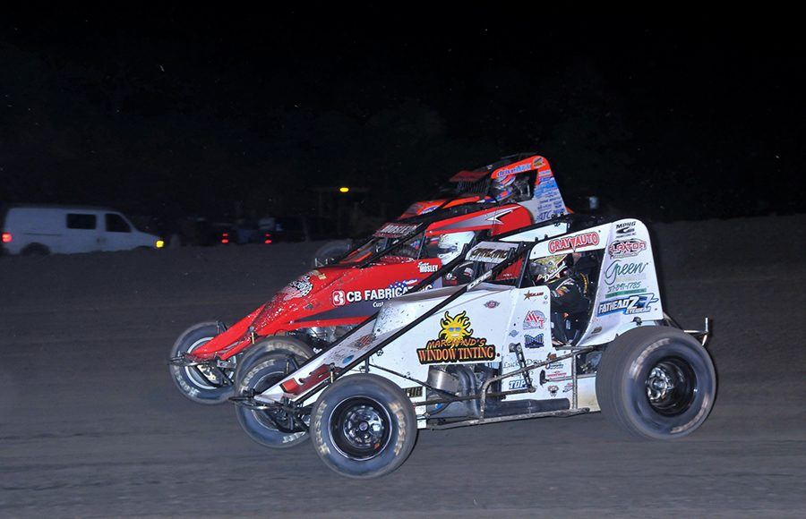 Dave Darland (36) and Brady Bacon (69) split Evan Mosley during Friday's USAC AMSOIL National Sprint Car Series feature at Gas City I-69 Speedway. (Randy Crist Photo)
