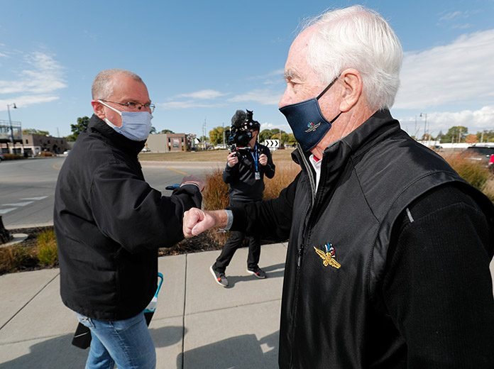 Roger Penske welcomes a fan at the Indianapolis Motor Speedway front gates Thursday. (IndyCar Photo)