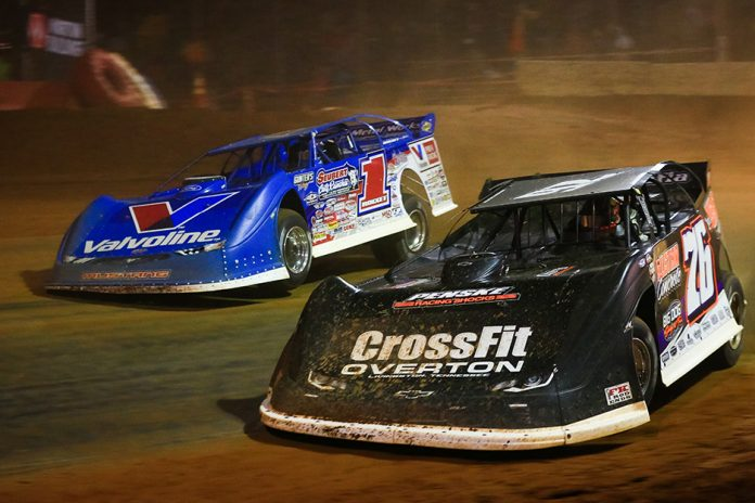 Brandon Overton (76) charges under Brandon Sheppard at Cherokee Speedway. (Zachary Kloosterman photo)