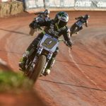 Jared Mees (9) leads the American Flat Track field at Dixie Speedway. (AFT photo)