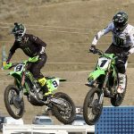 Eli Tomac (1) and Adam Cianciarulo (9) fly through the air during Saturday's Lucas Oil Pro Motocross event at Thunder Valley Motocross Park. (Don Holbrook Photo)