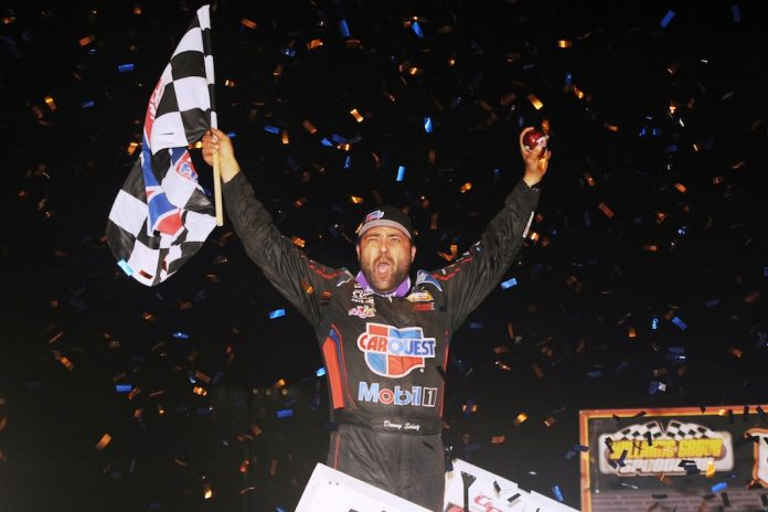 A jubilant Donny Schatz celebrates in victory lane at Williams Grove Speedway. (Julia Johnson photo)