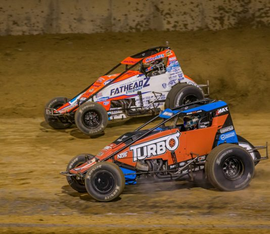 Tyler Courtney (7) and Brady Bacon battle for the lead at Lawrenceburg Speedway. (Dallas Breeze photo)